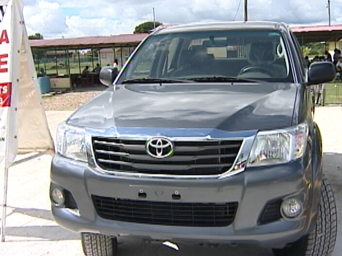 drives off in a spanking new 2014 Toyota Hilux | Channel5Belize.com